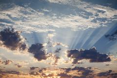 sunset, clouds gathering, in the sky over black rock desert, nevada. - stock photo