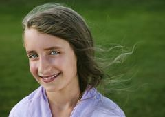 portrait of a smiling nine year old girl. - stock photo