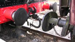 Steam train buffers as engine leaves coaches Stock Footage