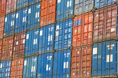 A stack of cargo containers, commercial freight containers, packed together a Stock Photos