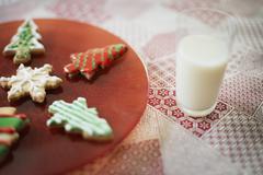 organic homemade christmas cookies and a glass of milk. - stock photo