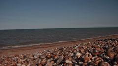 Flat Seas in Sun on Shingle Stock Footage