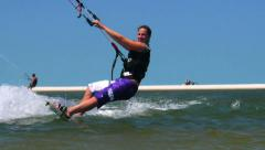 Young female kiteboarding Stock Footage