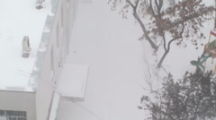 Extreme Blizzard Detail Of Snow On Top Of A Building Disaster,  Aerial Tilt-Shot - stock footage
