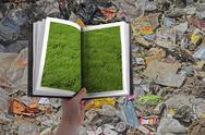 Stock Illustration of garbage on green land in past , concept