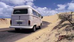 Hippie van driving through the desert Stock Footage