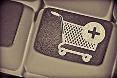 Stock Photo of computer key with a shopping cart symbol on it,