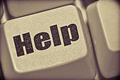 Stock Photo of help concept with computer key on keyboard