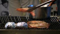 Close up baked prawns and potatoes on the grill, street seafood, Asia Stock Footage