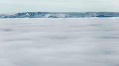 Sea of clouds over the mountain valley - timelapse video Stock Footage