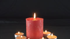 Big Red Candle Surrounded By Smaller Candles Gets Blown Off Medium Shot - stock footage
