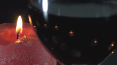 Big Red Candle And A Glass Of Wine Unfocused Close-Up Stock Footage