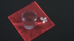 A Glass Of Water And Some Pills Aside High Angle Shot Stock Footage
