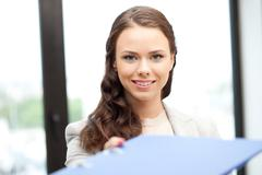 woman with folder - stock photo