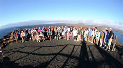 Tourists on the summit of Bartolome Island in Galapagos National Park and Marine Stock Footage