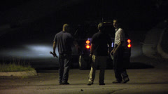 Investigators and night search Stock Footage