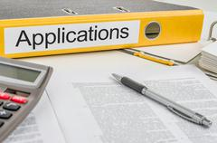 Folder with the label applications Stock Photos