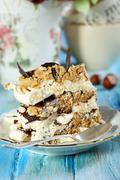 piece of cake of meringue and chocolate. - stock photo
