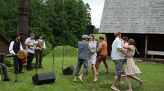 Country band play folk music and teenagers artists dance Stock Footage