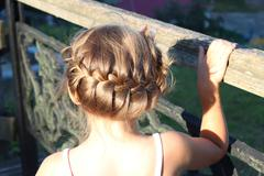 little fashionable girl with beautiful coiffure - stock photo