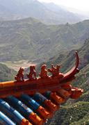 qilin and dragon figurines adorn the roof of a taoist taoist temple in north - stock photo