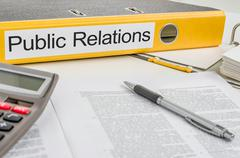 Folder with the label public relations Stock Photos