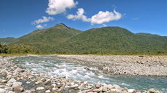 Mountains, clouds and the clear blue waters of the Huequi River in Southern Stock Footage
