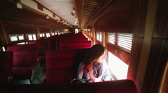 Lonely traveler in old train Stock Footage