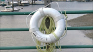 Stock Video Footage of Life Preserver on railing