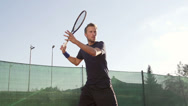Stock Video Footage of Slow-Mo: Professional Tennis Player Hits The Ball With Forehand Stroke