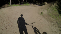 FIRST PERSON VIEW: Bmx biker hiking Stock Footage