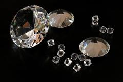 Several gems and diamonds at black background Stock Photos