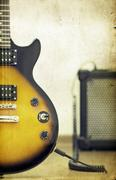 guitar and amplifier - old styled photo - stock photo