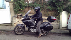 Motorbike courier departs very short version #2 - stock footage