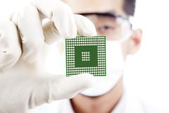 Male scientist shows a microchip Stock Photos