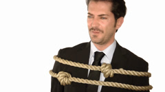 A tied up businessman Stock Footage