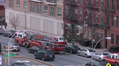Stock Video Footage of Firefighters respond to an emergency in Brooklyn.