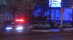 Police respond on an emergency in Brooklyn at night. Stock Footage