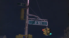 View of street signs and a traffic light at 3rd Street in Brooklyn. Stock Footage