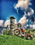 Vintage red motorbike on a alpin summer landscape Stock Photos