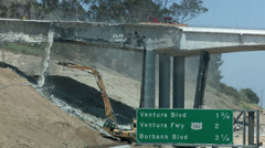 Construction crews tear down a portion of a bridge stretching over the 405 Stock Footage
