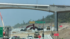 Excavators dig near an empty stretch of the 405 freeway in Los Angles as crews Stock Footage