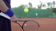 Slow Motion Of Tennis Racket Side Hitting The Ball - stock footage