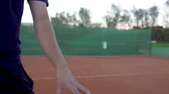 Tennis Player Throws And Catches The Ball On Clay Court Stock Footage
