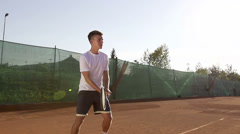 Stock Video Footage of Young Tennis Player Hitting The Ball With Forehand Stroke