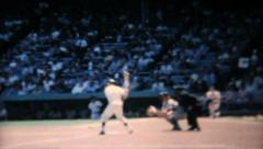 Stock Video Footage of Professional Baseball Game Batter Hitting Ball-1967 Vintage 8mm film