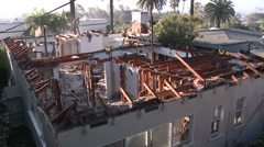Time lapse of crews demolishing a house. Stock Footage