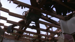 Tilt down from roof beams and panning shots around a house in the process of Stock Footage