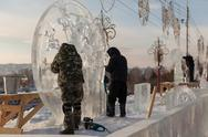 "Stock Photo of festival ""magic ice of siberia"", participants create sculptures from ice"