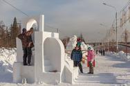 "Stock Photo of festival ""magic ice of siberia"", participants create sculptures from snow"